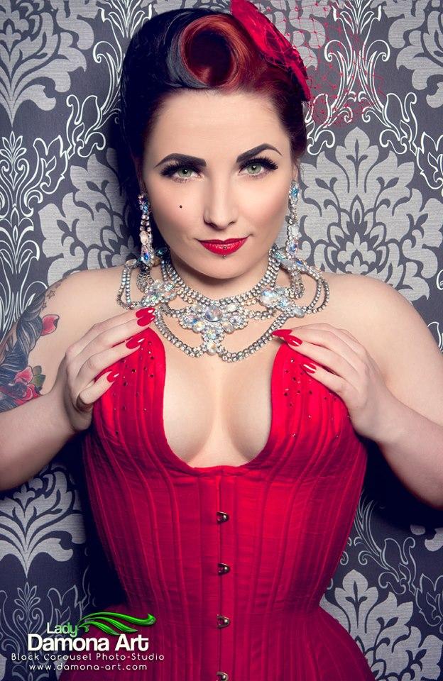 Miss Anne Thropy wears a red silk longline overbust.