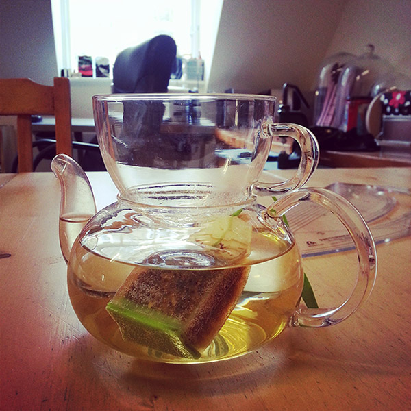 Tea infusing in a glass teapot