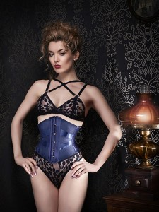 Navy ribbon corset and matching navy lace lingerie.