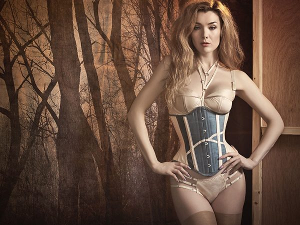 """The silk """"Régate"""" lingerie set features delicate strapping and a lingerie harness."""