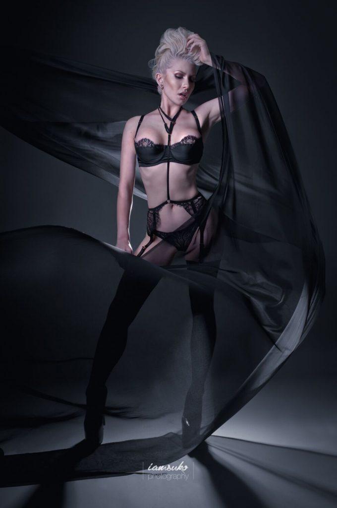 Colour image of Ryo Love wearing our bra panties and suspender belt by Iamsuko.