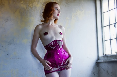 Waspie corset dress in pink silk satin with gold lace.,