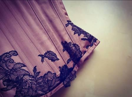 Black lace applique on a satin corset