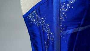 lace applique and swarovski crystal on a blue corset
