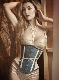 Model wears an ivory and green corset.