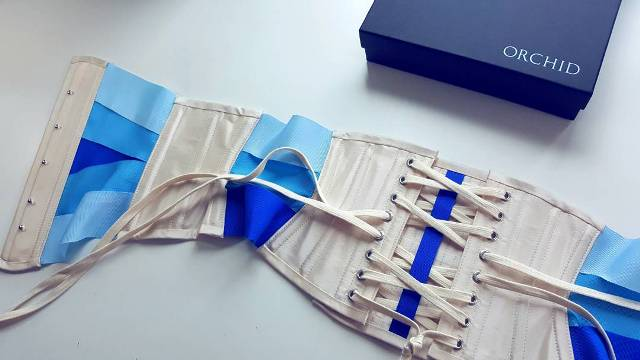 Ribbon corset with branded box.