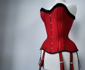 Red silk overbust corset for a male tightlacer.
