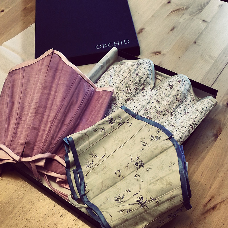A set of three corsets embellished and ready to go to their new home.