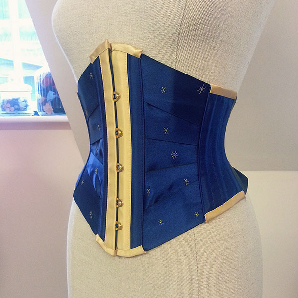 Blue and gold ribbon corset with star embroidery.