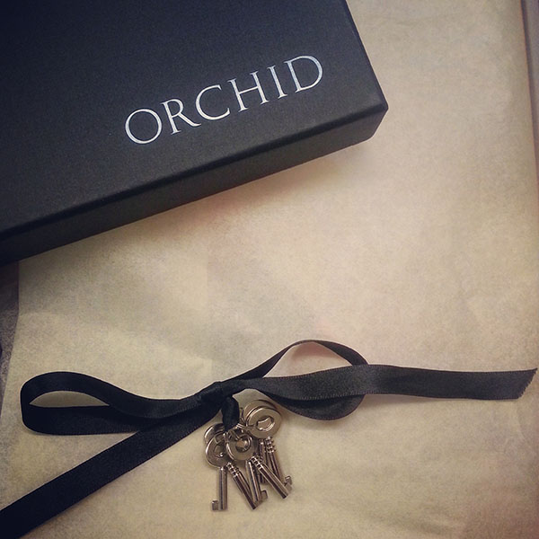 Keys in an Orchid Corsetry box.