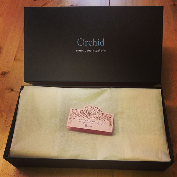 A wrapped parcel from Orchid Corsetry.