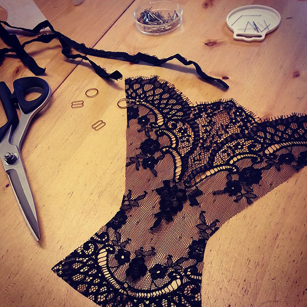 A pair of lace panties mid construction.