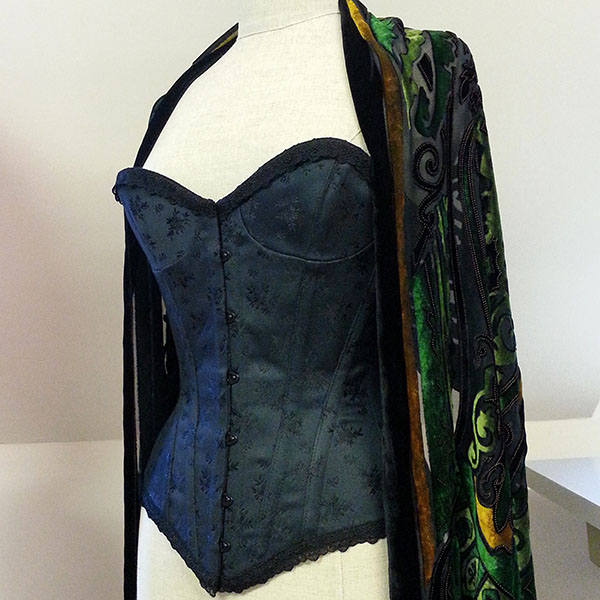 A black cupped overbust corset on a mannequin.