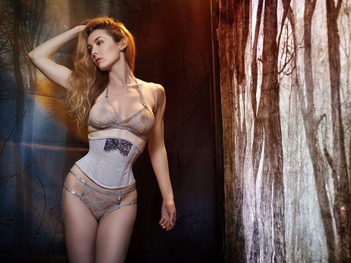 Model wears grey waspie and matching lingerie