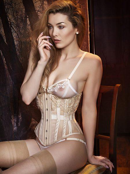 Miss Miranda wears a sheer ivory underbust corset.