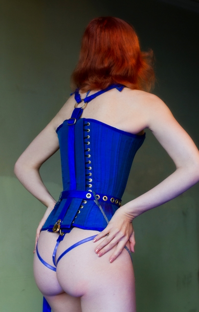 Back view of pony play overbust
