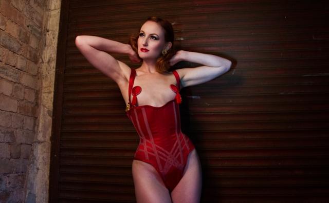 Model wearing a scarlet silk locking corset body