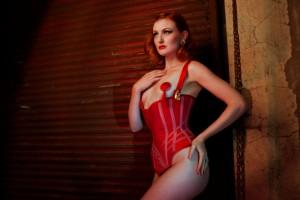 Anita De Bauch wearing a scarlet silk chastity corset