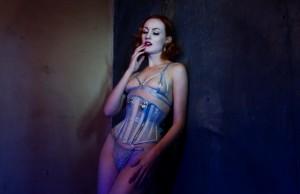 Model wears sheer silver waspie and lingerie