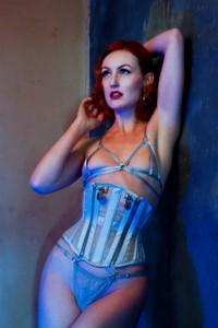 Model wears sheer silver locking corset