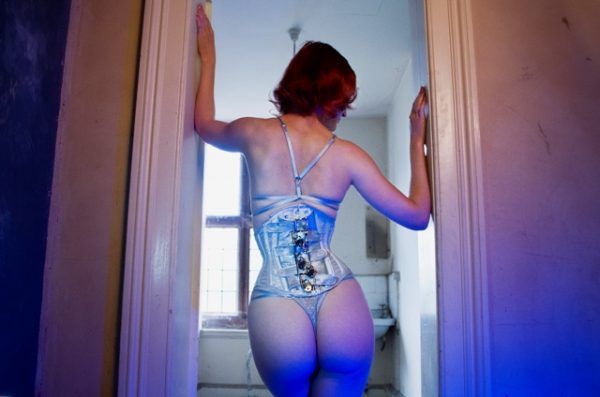 Back view of locking punishment corset