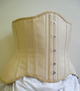 Male corset in beige spot coutil with Edwardian hip line.