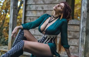 Model wears Soirée waspie by Orchid Corsetry