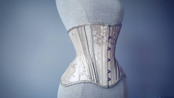 Silk training corset on a mannequin.