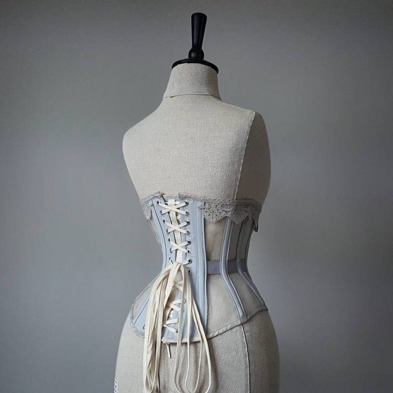 The Perle ivory mesh corset in dove grey coutil as seen from the back.