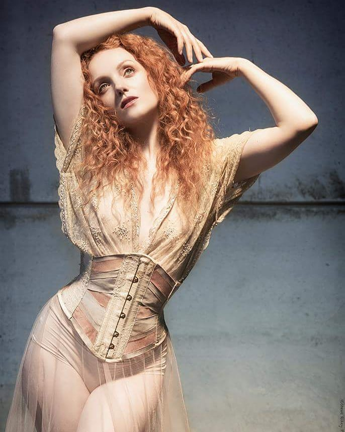 Ivory Flame wearing a silk print ribbon corset