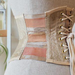 Blush silk ribbon corset from rear