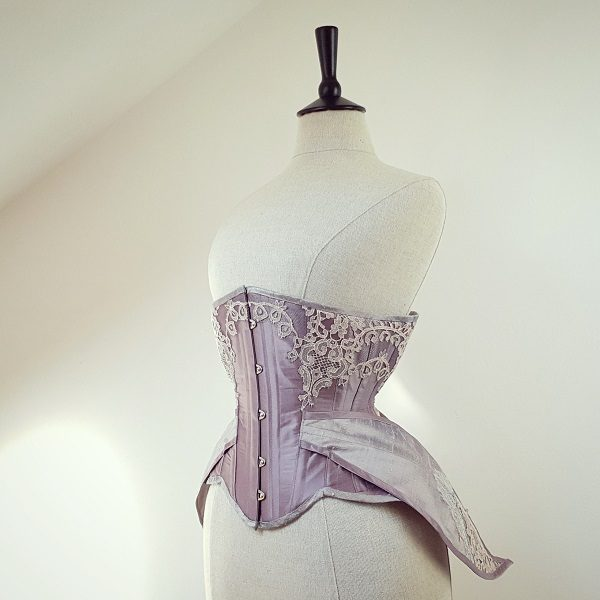 A winged corset in contrasting silks