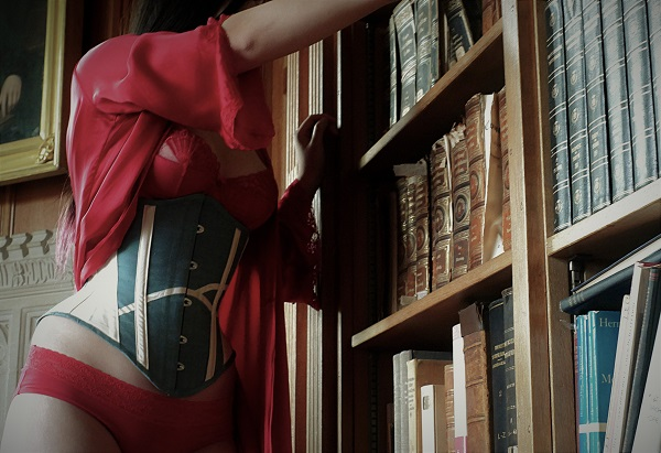 Competition winner wearing corset in a library