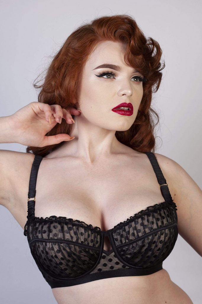 Miss Deadly Red wears a black Playful Promises bra