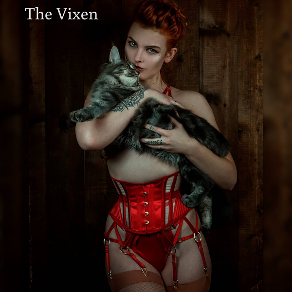 model wears red waspie with mesh panels, holding a cat. Classic valentines style