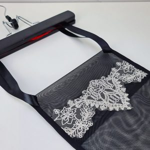close up of corset storage bag lace
