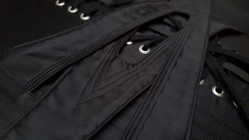 Close up of locking corset straps